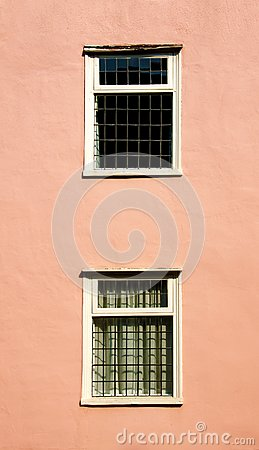 Windows on a pink wall