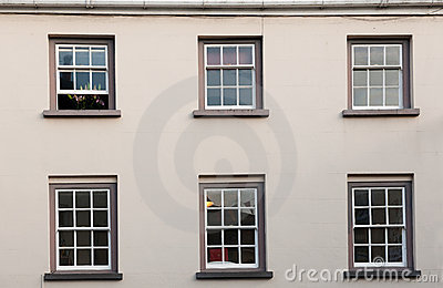 Windows on a white wall.