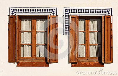 Windows with wooden shutters.