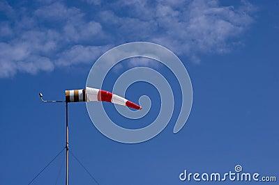 Windsock on a blue sky background