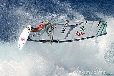 Windsurfer flying on wave Editorial Photography