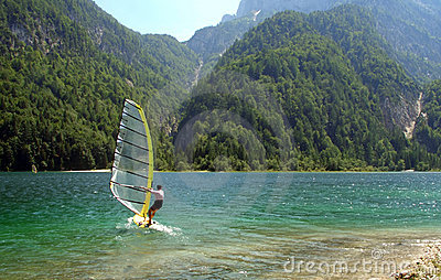 Windsurfer in a mountain lake