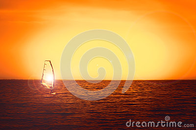 Windsurfer silhouette at sea sunset. Beautiful beach seascape. Summertime watersports activities, vacation and travel Stock Photo