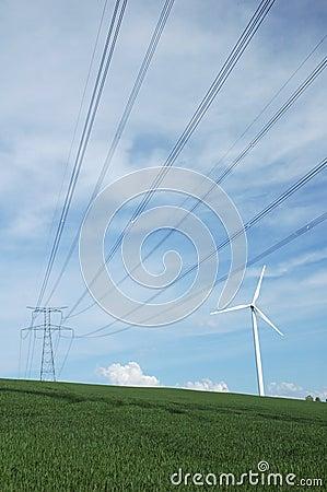 A windturbine close to a electric pylon