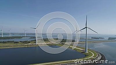 Windturbine vanuit luchtperspectief, Drone view in windpark krammersluizen, een windmolenpark in het grovelingmeer in Nederland. stock footage