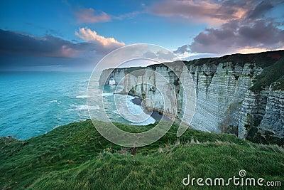 Windy sunrise over cliff in Atlantic ocean