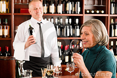 Wine bar senior woman enjoy wine glass