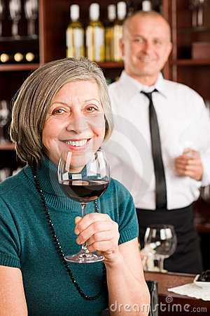 Wine bar senior woman enjoy wine glass