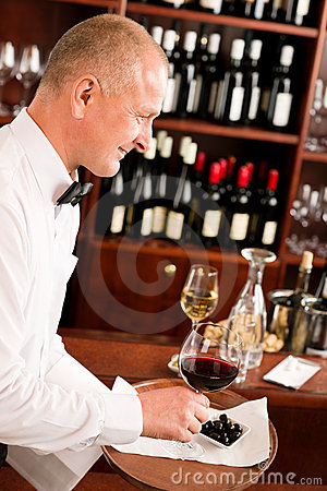 Wine bar waiter mature serve glass restaurant