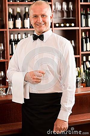 Wine bar waiter mature smiling in restaurant