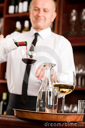 Wine bar waiter pour glass in restaurant
