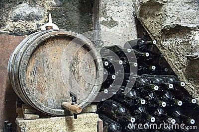 Wine barrel and bottles