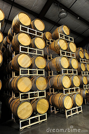 Wine barrels stacked in winery side