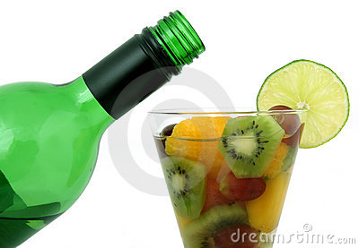 Wine bottle and fruit glass with lime and wine