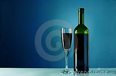 Wine bottle and glass on a blue background