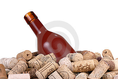 Wine bottle and a lot of wine-corks isolated