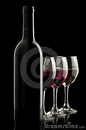 Wine bottle with red, white and rose wine glasses