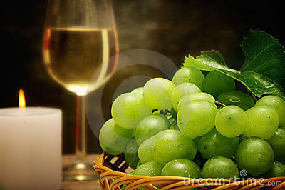 Wine candle and grapes