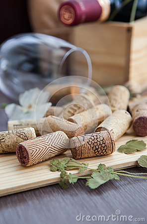 Wine corks on the table with glass and bottle on the background
