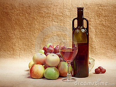 Wine and fruit against brown sacking