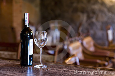 Wine and glass on the bar