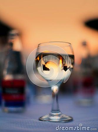 Wine glass on beach table