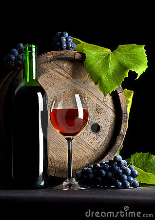 Wine glass, cask and grapes