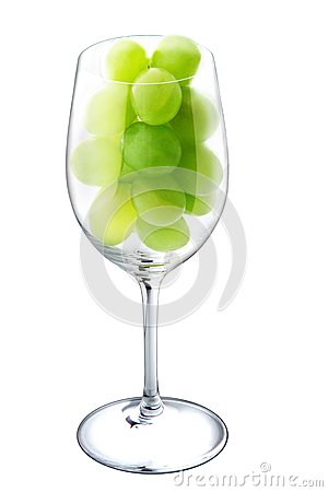 Wine glass with green grapes.