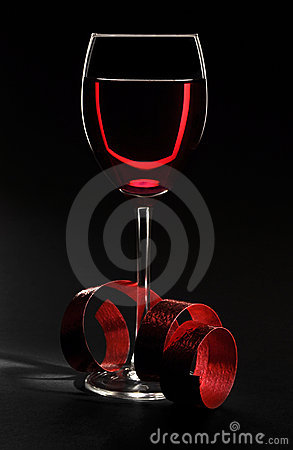 Wine glass with ribbon on black