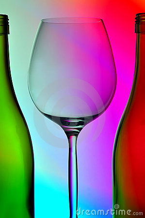 Wine glass and two bottles