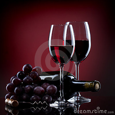 Wine in glasses with grape and bottle