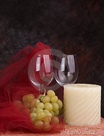 Wine glasses, grapes, candle