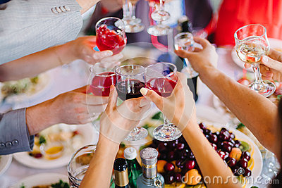 Wine glasses in hands group of people for happy party