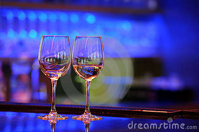 Wine glasses with light bokeh