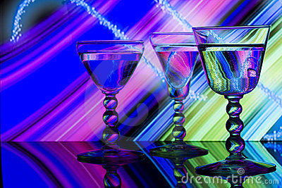 Wine glasses on neon striped background