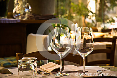 Wine glasses and table setting in restaurant