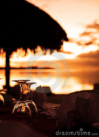 Wine glasses and tropical beach sunset