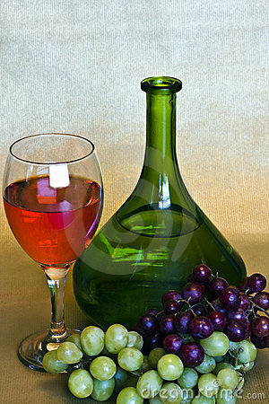 Wine, bottle and grapes