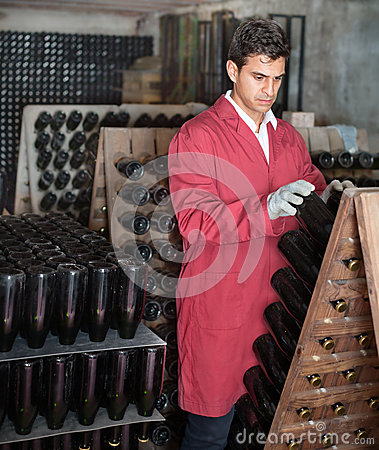 Free Wine Maker Taking Care Of Seasoning Bottles Royalty Free Stock Photography - 79300507