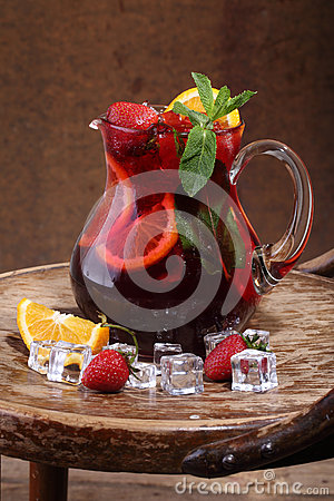 Free Wine Of Sangrija In A Transparent Jug With A Strawberry, An Oran Royalty Free Stock Photography - 56723827