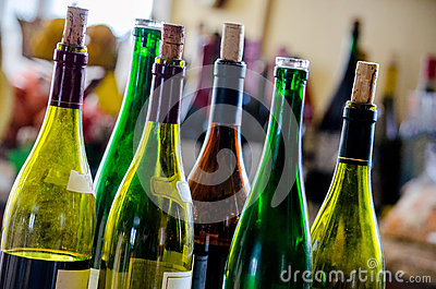 Wine and wine bottles with corks stock photo image 42978118 for Colored glass bottles with corks