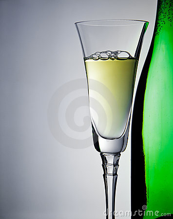 Wineglass and bottle