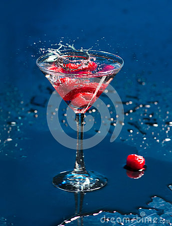 The wineglass with raspberries