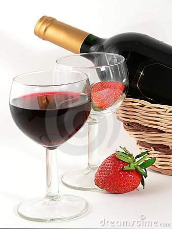 Wineglass with red wine and strawberry