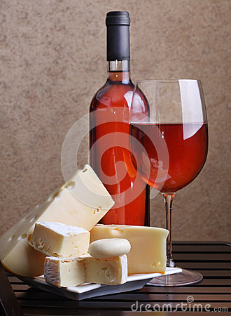 Wineglass, wine and cheese