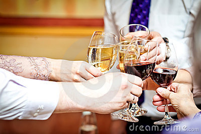Wineglasses in a celebration clink