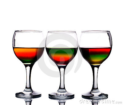 Wineglasses filled with multicolored cocktail