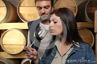 Winegrowers tasting wine