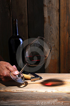 Winemaker s hand with glass