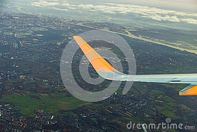 Wing of aircraft with aerial of Hamburg